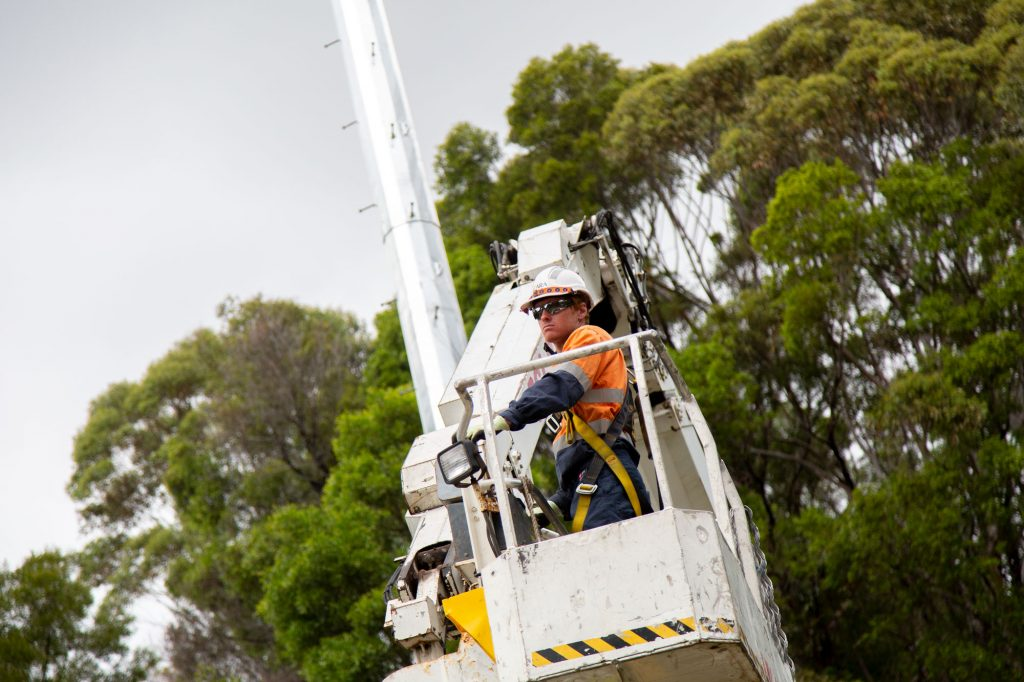high voltage electrician sitting in cherrypicker