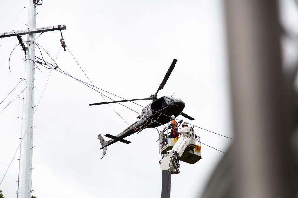 a helicopter installing high voltage overhead powerlines