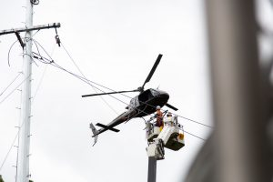 a helicopter installing electrical overhead powerlines
